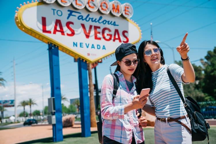 Tourists posing near Las Vegas sign