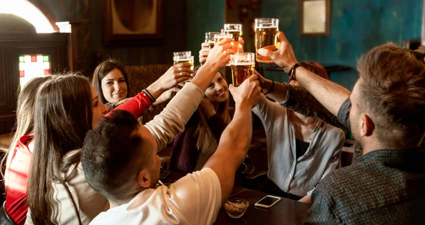 People toasting beer at a brewery