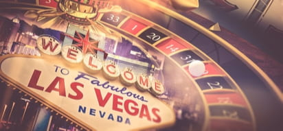 """a roulette wheel styled around the """"welcome to fabulous las vegas"""" sign"""