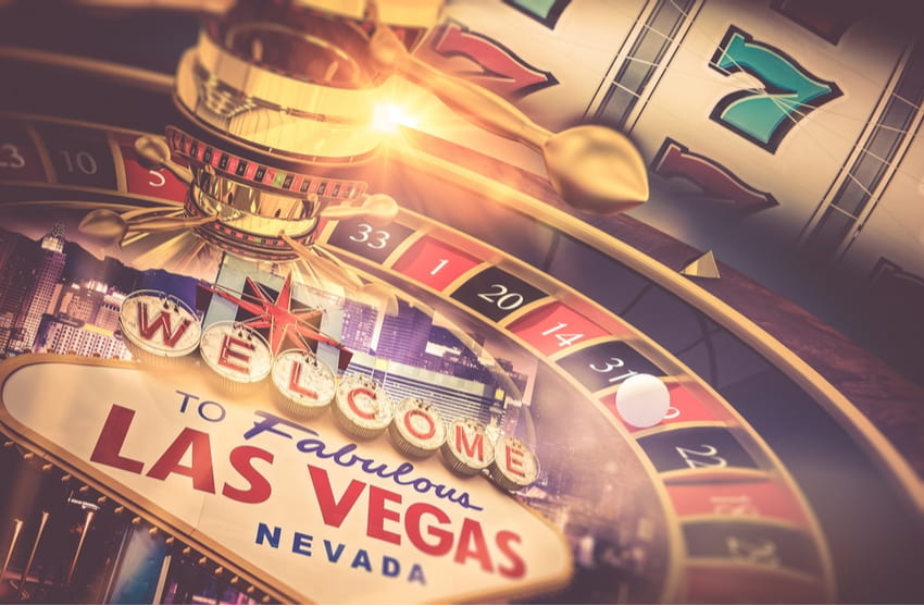 """a roulette table styled over the """"welcome to fabulous las vegas"""" sign"""