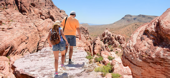 two hikers hike in Red Rock Canyon Park